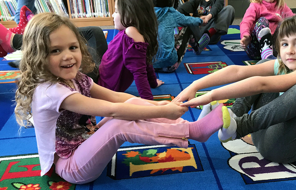 Preschoolers using Yoga in Classroom
